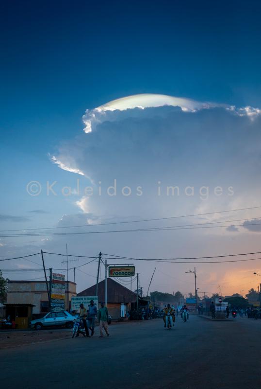 Africa;Benin;Cities;City;Cityscape;Clouds;Evening;Kaleidos;Kaleidos images;Mopeds;People;Tarek Charara